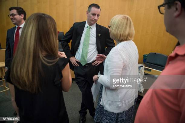 Rep Brian Fitzpatrick RPa talks with guests during a town hall meeting in Bensalem Pa on August 22 2017