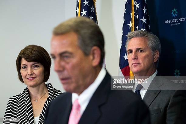 Rep Cathy McMorris Rodgers and House Majority Leader Kevin McCarthy look on as Speaker of the House John Boehner take questions from the media during...