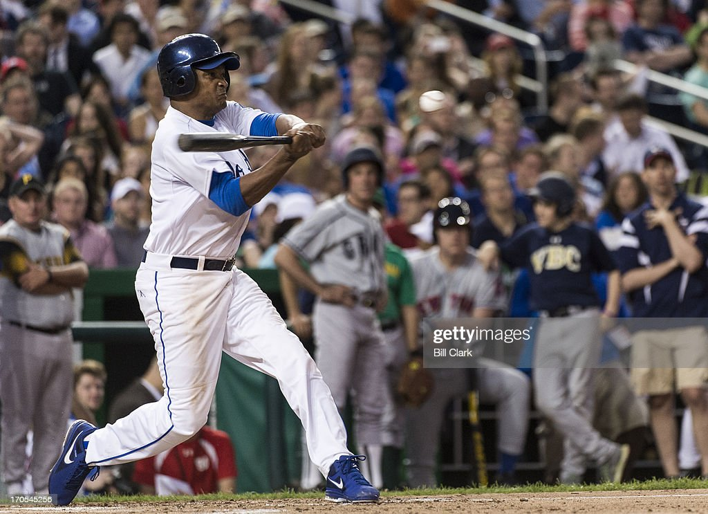 Rep. Cedric Richmond, D-La., hits a triple in the 3rd inning of the 52nd annual Congressional Baseball Game at national Stadium in Washington on Thursday, June 13, 2013.