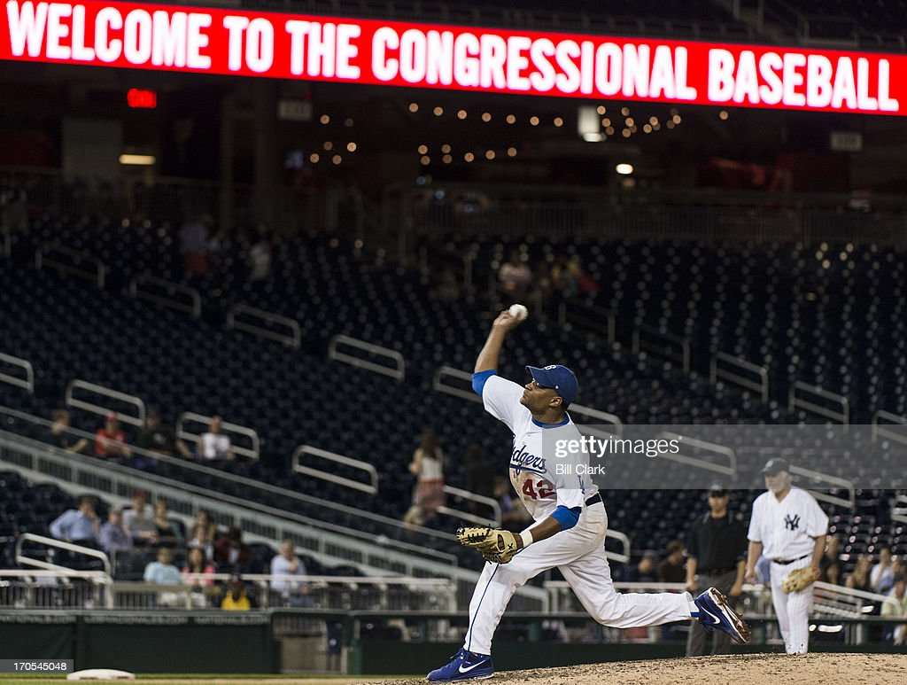 Rep. Cedric Richmond, D-La., pitches in the 52nd annual Congressional Baseball Game at national Stadium in Washington on Thursday, June 13, 2013.