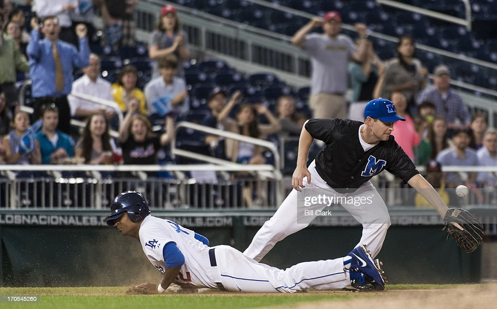 Rep. Cedric Richmond, D-La., slides safely at third base for a triple in the 3rd inning of the 52nd annual Congressional Baseball Game at national Stadium in Washington on Thursday, June 13, 2013.
