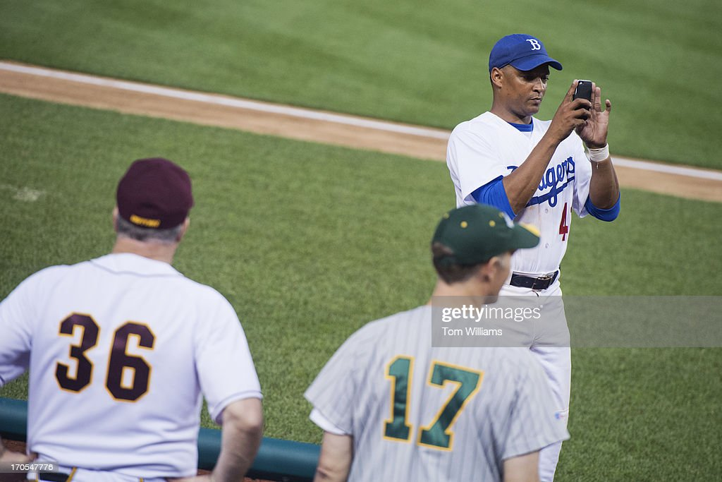 Rep. Cedric Richmond, D-La., takes pictures of his team during the Congressional Baseball game where the Democrats beat the Republicans 22-0 at Nationals Park.