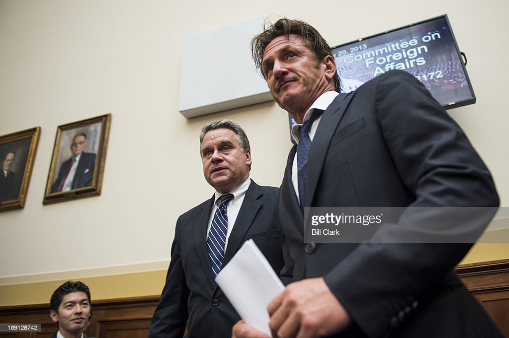 Rep. Chris Smith, R-N.J., left, escorts actor Sean Penn, founder and CEO of the J/P Haitian Relief Organization, to the witness table for the House Foreign Affairs Committee TopicAfrica, Global Health, Global Human Rights and International Organizations Subcommittee hearing on 'Advocating for American Jacob Ostreicher's Freedom after Two Years in Bolivian Detention' on Monday, May 20, 2013.