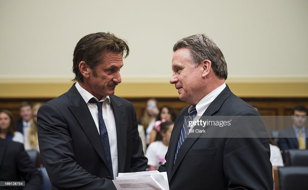 Rep. Chris Smith, R-N.J., right, escorts actor Sean Penn, founder and CEO of the J/P Haitian Relief Organization, to the witness table for the House Foreign Affairs Committee TopicAfrica, Global Health, Global Human Rights and International Organizations Subcommittee hearing on 'Advocating for American Jacob Ostreicher's Freedom after Two Years in Bolivian Detention' on Monday, May 20, 2013.