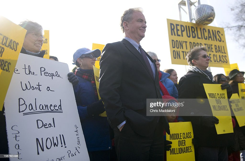 Rep. Chris Van Hollen, D-Md., prepares to speak at 'The Action' rally urging the Republicans in Congress 'not to drop the ball on the middle class, and give massive tax breaks to the richest Americans as the New Year and the impending $2,000 tax hike on middle-class families approaches.'