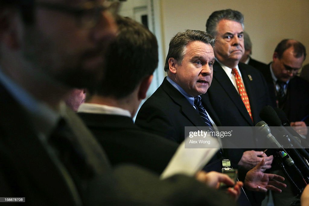 U.S. Rep. Christopher Smith (R-NJ) (3rd L) and Rep. Peter King (R-NY) (2nd R) speak to the media after a meeting regarding the Sandy aid bill with Speaker of the House Rep. John Boehner (R-OH) January 2, 2013 on Capitol Hill in Washington, DC. The House Republican leadership was criticized for not acting on the Senate passed legislation for Hurricane Sandy disaster aid.
