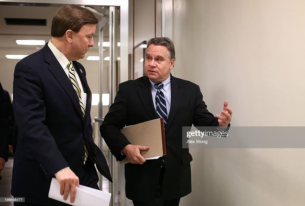U.S. Rep. Christopher Smith (R-NJ) (R) talks with Rep. Mike Rogers (R-AL) (L) as they arrive for a vote at the Capitol January 15, 2013 on Capitol Hill in Washington, DC. The House is scheduled to vote on the $50.7 billion Disaster Relief Appropriations for victims of superstorm Sandy later the day.