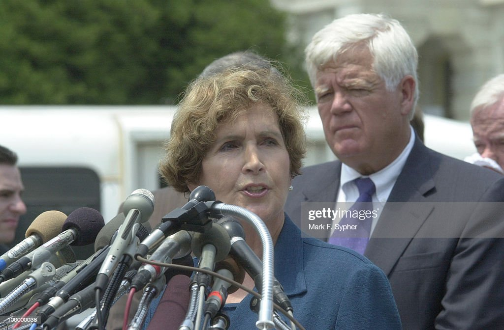 Rep. Constance A. Morella (R-MD) addresses the large gathering of press while Rep. Jim McDermott (D-WA), right, patiently waits for his turn to speak.