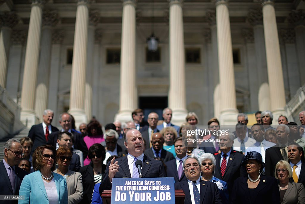 Rep. Dale Kildee (D-MI) (C) joins fellow Democratic members of Congress to call on Republicans to postpone the Memorial Day holiday recess on the steps of the House of Representatives at the U.S. Capitol May 26, 2016 in Washington, DC. The Democratic leaders highlighted the need for 'action on the Zika virus, the opioid epidemic, the Flint water crisis and the president's nomination of Judge Merrick Garland to the Supreme Court.'