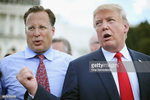 Rep Dave Brat reacts as Republican presidential candidate Donald Trump says it would be 'the end of his political career' if Brat does not support...