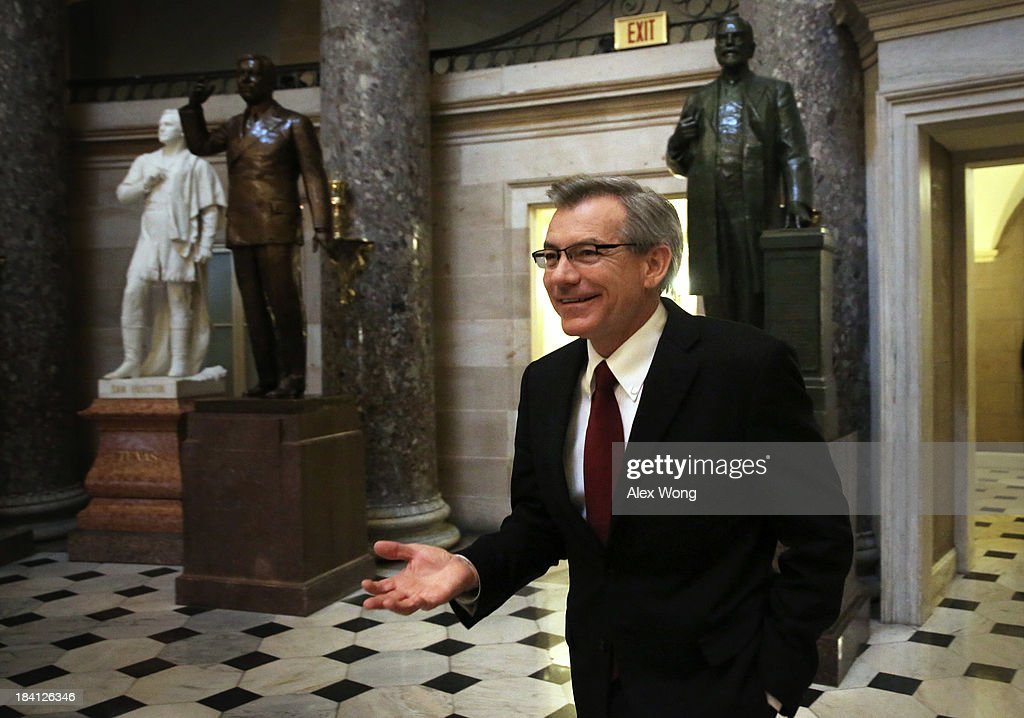 U.S. Rep. David Schweikert (R-AZ) talks to members of the media as he walks through the Statuary Hall at the Capitol October 11, 2013 on Capitol Hill in Washington, DC. On the 11th day of a U.S. government shutdown, President Barack Obama spoke with Speaker of the House John Boehner (R-OH) on the phone and they agreed that they should keep talking.