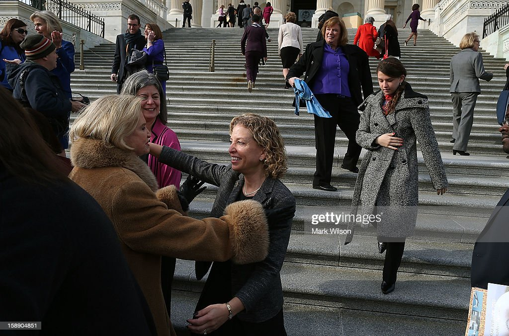 U.S. Rep. Debbie Wasserman Schultz (D-FL) (3rd L) greets female members of House Democratic Caucus after a photo op on January 3, 2013 in Washington, DC. The new 113th Congress will be sworn in today.