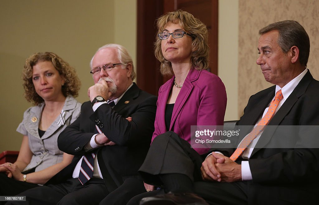 U.S. Rep. Debbie Wasserman-Schultz (D-FL), U.S. Rep. Ron Barber (D-AZ), former U.S. Rep. <a gi-track='captionPersonalityLinkClicked' href=/galleries/search?phrase=Gabrielle+Giffords&family=editorial&specificpeople=6961081 ng-click='$event.stopPropagation()'>Gabrielle Giffords</a> (D-AZ) and Speaker of the House <a gi-track='captionPersonalityLinkClicked' href=/galleries/search?phrase=John+Boehner&family=editorial&specificpeople=274752 ng-click='$event.stopPropagation()'>John Boehner</a> (R-OH) attend the dedication ceremony of the Gabriel Zimmerman Meeting Room in the U.S. Capitol Visitors Center April 16, 2013 in Washington, DC. A member of Giffords' Congressional staff, Gabriel Zimmerman was murdered during a shooting spree January 8, 2011 that left six dead and 13 injured, including Giffords.