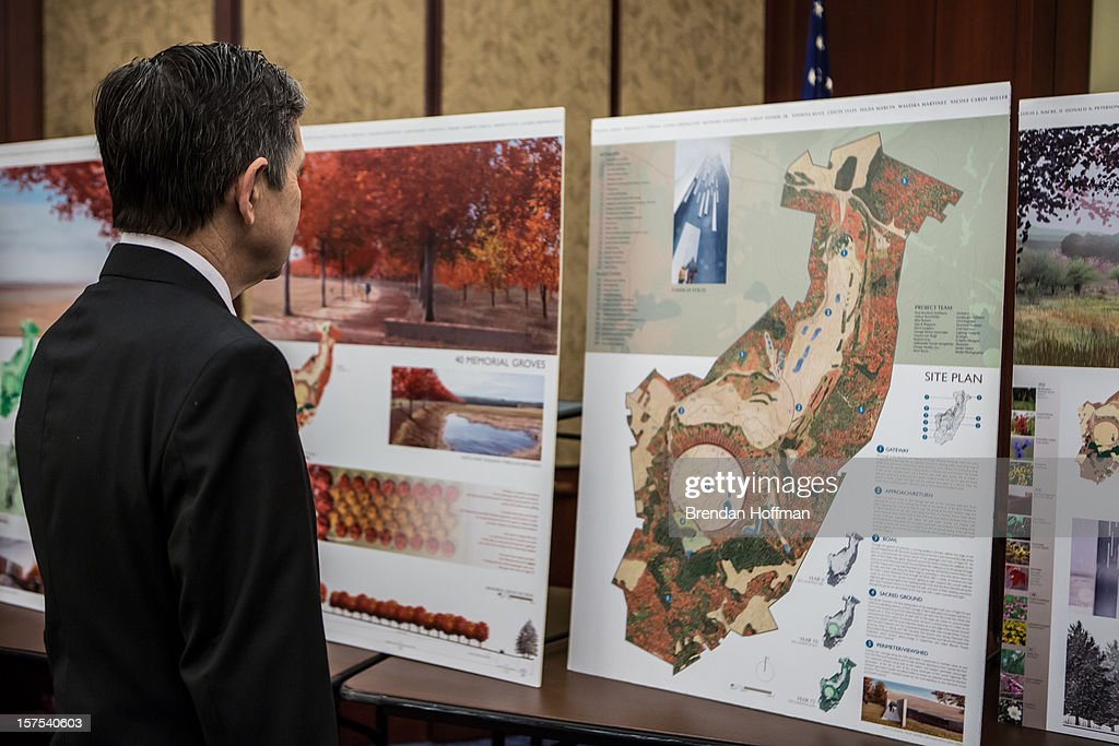 U.S. Rep. Dennis Kucinich (D-OH) looks at renderings of the planned Flight 93 National Memorial at an event on Capitol Hill to raise awareness of the unfinished national memorial to the passengers and crew of Flight 93 on December 4, 2012 in Washington, DC. The plane was hijacked on September 11 but passengers and crew fought back, crashing the plane into a field in Shanksville, Pennsylvania.