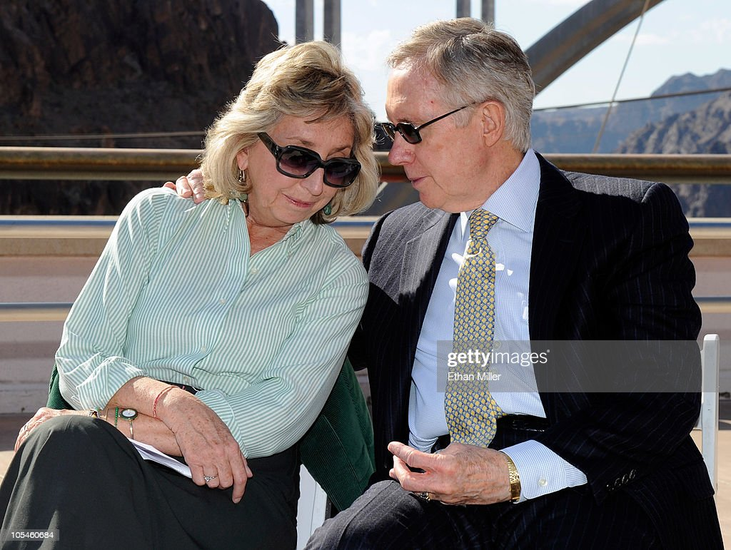 U.S. Rep. Dina Titus (D-NV) (L) and U.S. Senate Majority Leader <a gi-track='captionPersonalityLinkClicked' href=/galleries/search?phrase=Harry+Reid+-+Politician&family=editorial&specificpeople=203136 ng-click='$event.stopPropagation()'>Harry Reid</a> (D-NV) talk while attending the dedication of the Mike O'Callaghan-Pat Tillman Memorial Bridge part of the Hoover Dam Bypass Project October 14, 2010 in the Lake Mead National Recreation Area, Nevada. The 1,900-foot-long structure sits 890 feet above the Colorado River, about a quarter of a mile downstream from the Hoover Dam. The USD 240 million project to relieve vehicle traffic on the Hoover Dam began in 2003, and is scheduled to be open to traffic by next week.