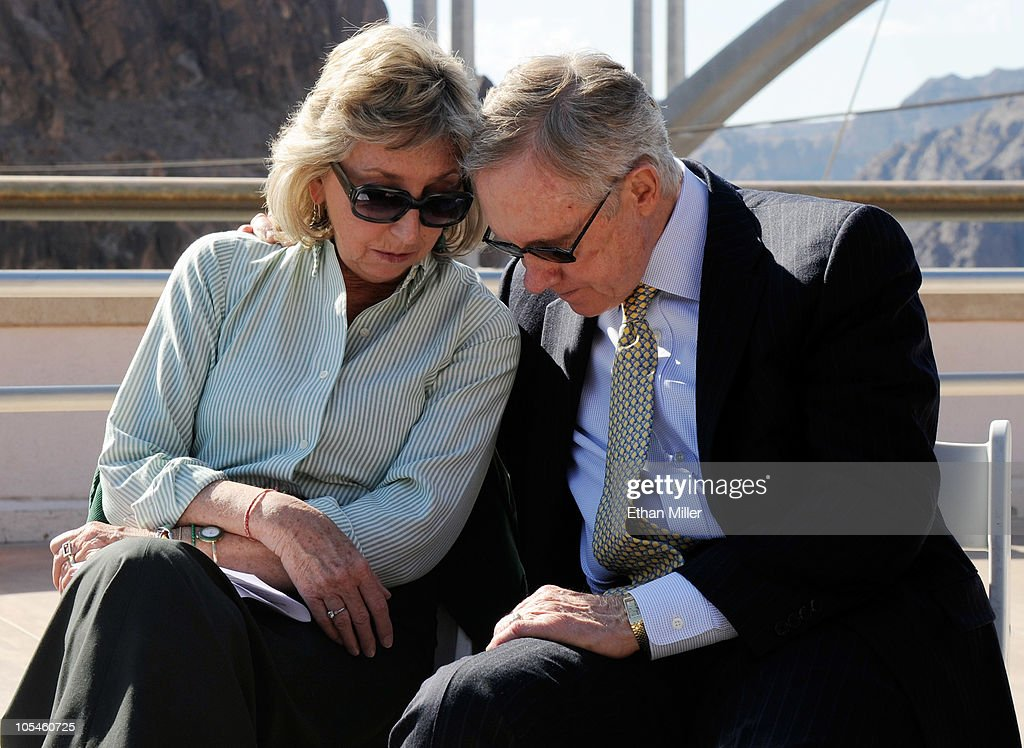 U.S. Rep. Dina Titus (D-NV) (L) and U.S. Senate Majority Leader Harry Reid (D-NV) talk while attending the dedication of the Mike O'Callaghan-Pat Tillman Memorial Bridge part of the Hoover Dam Bypass Project October 14, 2010 in the Lake Mead National Recreation Area, Nevada. The 1,900-foot-long structure sits 890 feet above the Colorado River, about a quarter of a mile downstream from the Hoover Dam. The USD 240 million project to relieve vehicle traffic on the Hoover Dam began in 2003, and is scheduled to be open to traffic by next week.