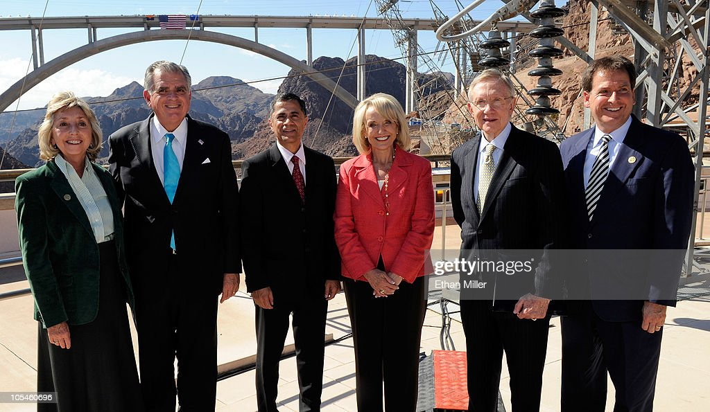 U.S. Rep. Dina Titus (D-NV), U.S. Transportation Secretary <a gi-track='captionPersonalityLinkClicked' href=/galleries/search?phrase=Ray+LaHood&family=editorial&specificpeople=598728 ng-click='$event.stopPropagation()'>Ray LaHood</a>, Federal Highway Administration Administrator Victor Mendez, Arizona Gov. Jan Brewer, U.S. Senate Majority Leader <a gi-track='captionPersonalityLinkClicked' href=/galleries/search?phrase=Harry+Reid+-+Politician&family=editorial&specificpeople=203136 ng-click='$event.stopPropagation()'>Harry Reid</a> (D-NV) and Nevada Lt. Gov. Brian Krolicki pose for photos at the dedication of the Mike O'Callaghan-Pat Tillman Memorial Bridge part of the Hoover Dam Bypass Project October 14, 2010 in the Lake Mead National Recreation Area, Nevada. The 1,900-foot-long structure sits 890 feet above the Colorado River, about a quarter of a mile downstream from the Hoover Dam. The USD 240 million project to relieve vehicle traffic on the Hoover Dam began in 2003, and is scheduled to be open to traffic by next week.