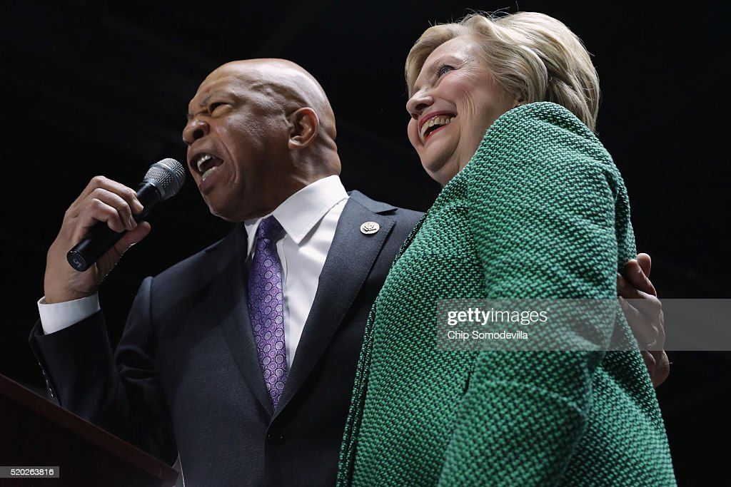 U.S. Rep. Elijah Cummings (D-MD) (L) announced his endorsement of Democratic presidential candidate Hillary Clinton (R) during a campaign rally at City Garage April 10, 2016 in Baltimore, Maryland. Voters will head to polling places for Maryland's presidential primary April 26.