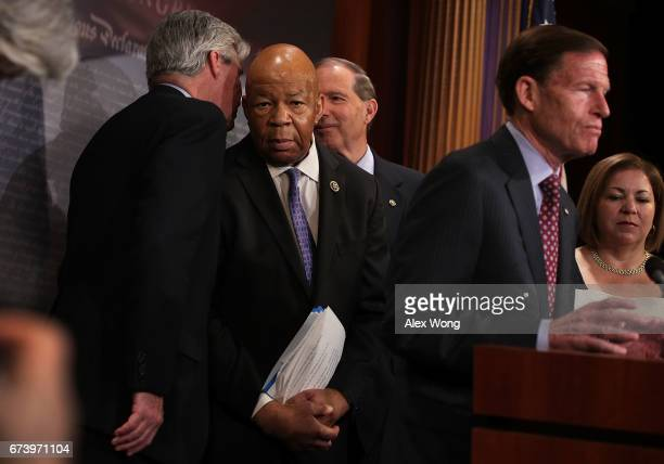S Rep Elijah Cummings listens to Sen Sheldon Whitehouse as Sen Richard Blumenthal speaks during a news conference at the Capitol April 27 2017 in...