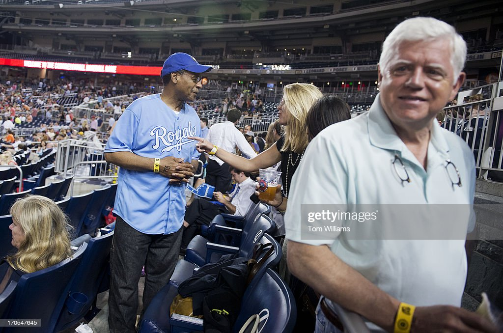Rep. Emanuel Cleaver, D-Ill., left, and Rep. John Larson, D-Conn., talk with spectators during the Congressional Baseball game where the Democrats beat the Republicans 22-0 at Nationals Park.