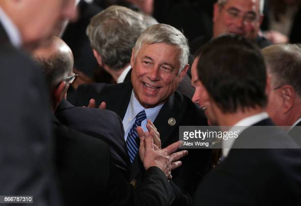 S Rep Fred Upton and other guests wait for the beginning of an event highlighting the opioid crisis in the US October 26 2017 in the East Room of the...