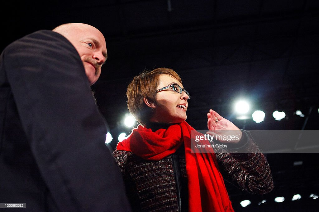 U.S. Rep. Gabrielle Giffords (D-AZ) and husband Mark Kelly wave goodbye to the thousand in attendance at the 'Remembering January 8th Candlelight Vigil' held at the University of Arizona Mall January 8, 2012 in Tucson, Arizona. The event was the culmination of several days commemorating the one year anniversary of a shooting rampage that killed six people and wounded more than a dozen more.