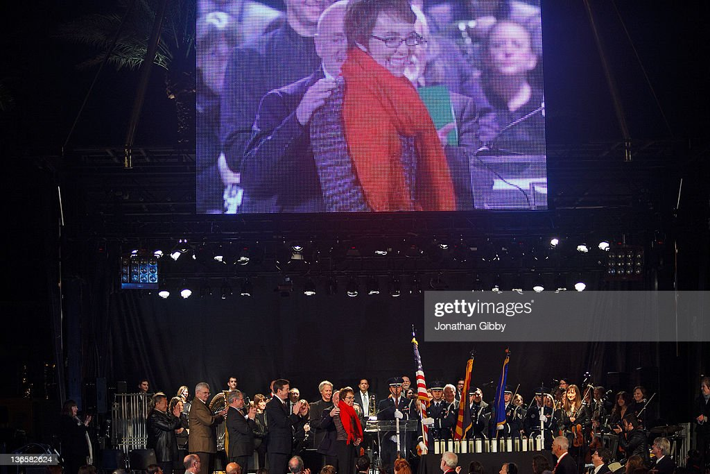 U.S. Rep. Gabrielle Giffords (D-AZ) (C) greets thousands in attendance during the 'Remembering January 8th Candlelight Vigil' held at the University of Arizona Mall January 8, 2012 in Tucson, Arizona. The event was the culmination of several days commemorating the one year anniversary of a shooting rampage that killed six people and wounded more than a dozen.