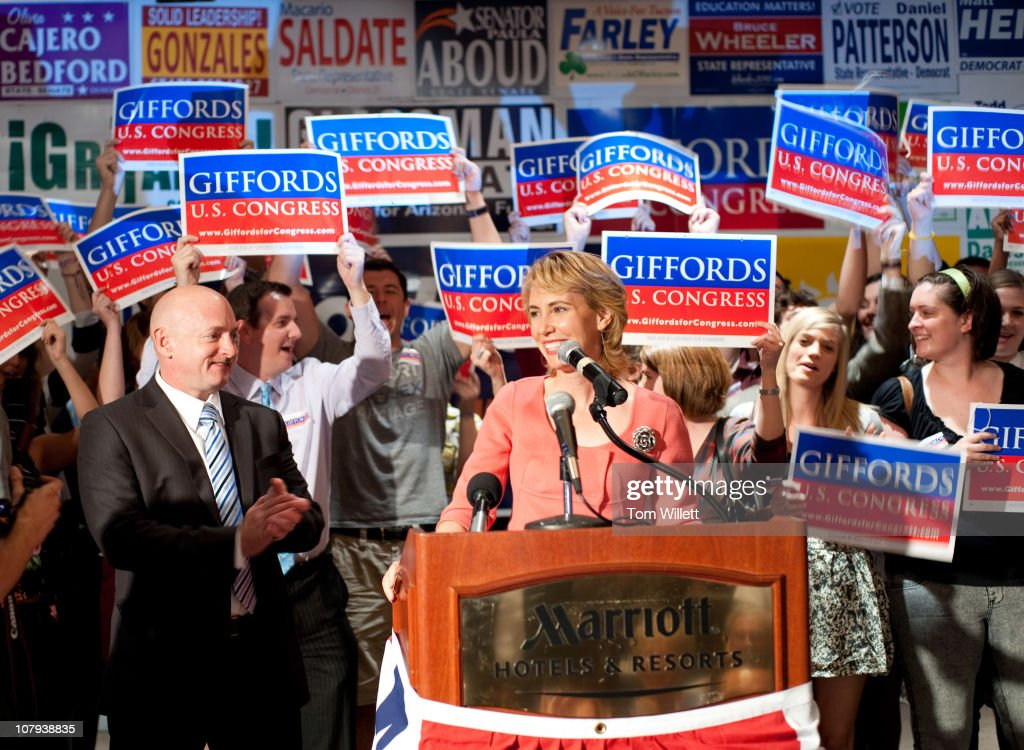 Rep Gabrielle Giffords speaks on election night at Democratic Election Headquarters as her husband Mark Kelly applauds at the Tucson Marriott...