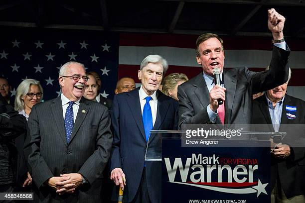 US Rep Gerry Connolly and former US Senator John Warner look on as Sen Mark Warner speaks during a Get Out the Vote rally for Democratic candidates...