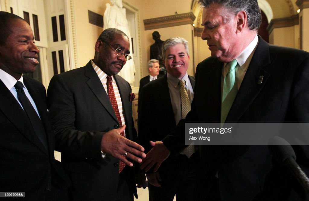 U.S. Rep. Gregory Meeks (D-NY) (2nd L) shakes hands with U.S. Rep. Peter King (R-NY) (R) as New York State Suffolk County Executive Steve Bellone (3rd L) and New York State Sen. Malcolm Smith (L) look on after a vote on the final passage of Disaster Relief Appropriations January 15, 2013 on Capitol Hill in Washington, DC. The House has approved the $50 billion Disaster Relief Appropriations for victims of superstorm Sandy.