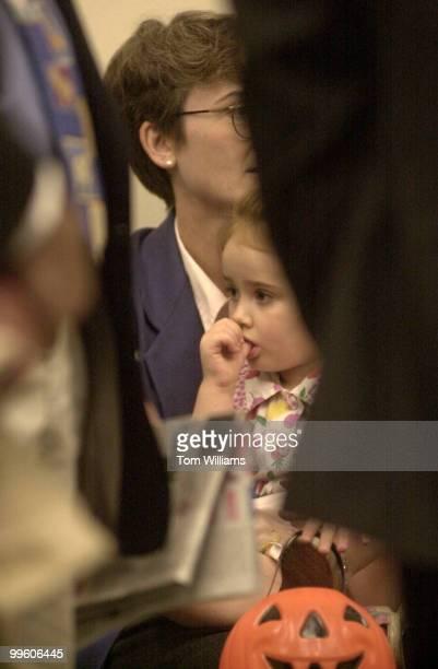 Rep Heather Wilson and 4 year old daughter Caitlin await the beginning of a reception that handed out money to charities that was raised by the...