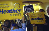 Rep Heather Wilson RNM supporters square of against Rep Steve Pearce RNM supporters in the lobby of the Albuquerque Marriott before the arrival of...
