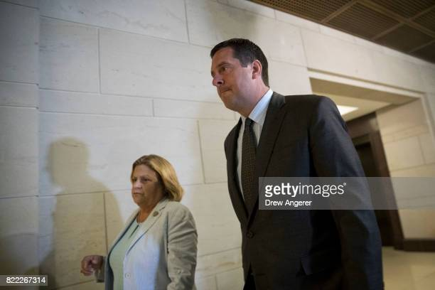 Rep Ileana RosLehtinen walks with House Intelligence Committee Chairman Rep Devin Nunes who previously had recused himself from the panel's Russia...