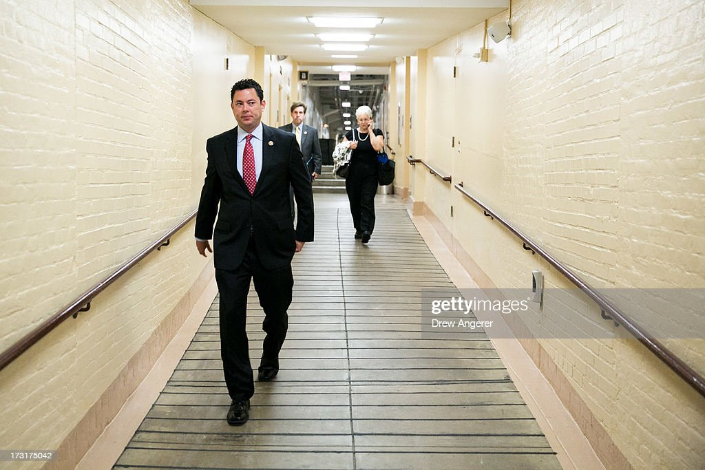 U.S. Rep. <a gi-track='captionPersonalityLinkClicked' href=/galleries/search?phrase=Jason+Chaffetz&family=editorial&specificpeople=5610304 ng-click='$event.stopPropagation()'>Jason Chaffetz</a> (R-UT) makes his way to a House GOP caucus meeting, on Capitol Hill, July 9, 2013 in Washington, DC. The Republican leadership discussed the immigration bill and the Obama administration's decision to delay a portion of the Affordable Care Act, which will extend the deadline for employer mandated health care to 2015. At right, Trey Radel (R-FL) and House Majority Leader Eric Cantor (R-VA) look on.