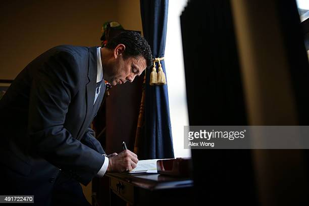 Rep Jason Chaffetz signs papers in his office October 7 2015 on Capitol Hill in Washington DC Rep Chaffetz is running in the race to succeed Speaker...