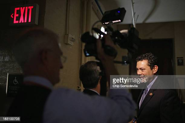 Rep Jason Chaffetz talks with reporters before attending a House Republican caucus meeting at the US Capitol October 4 2013 in Washington DC 'This...