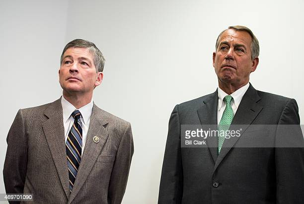 Rep Jeb Hensarling RTexas left and Speaker of the House John Boehner ROhio listen as other House GOP leaders speak to reporters following the House...