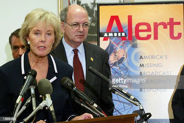 S Rep Jennifer Dunn speaks as Rep Martin Frost listens during a news conference introducing the National AMBER Alert Network Act September 5 2002 on...