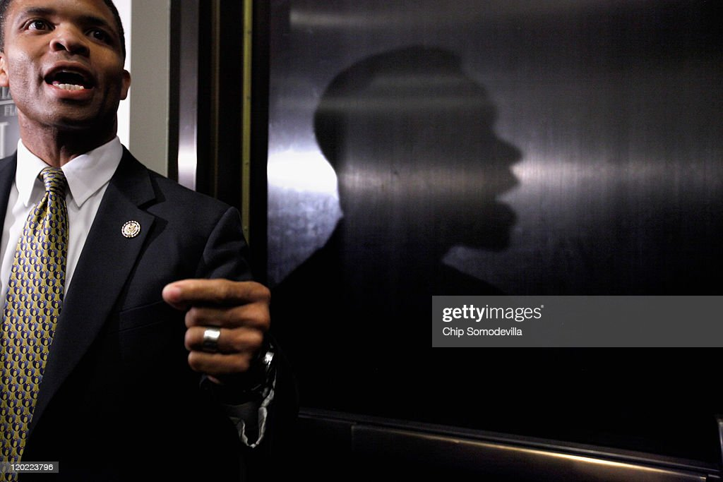 Rep Jesse Jackson Jr talks with reporters after a House Democratic caucus meeting with US Vice President Joe Biden at the US Capitol August 1 2011 in...