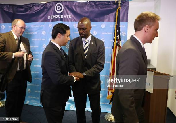 Rep Joaquin Castro and DNC Vice Chair Michael Blake shake hands after holding a press conference at the Democratic National Headquarters on July 19...