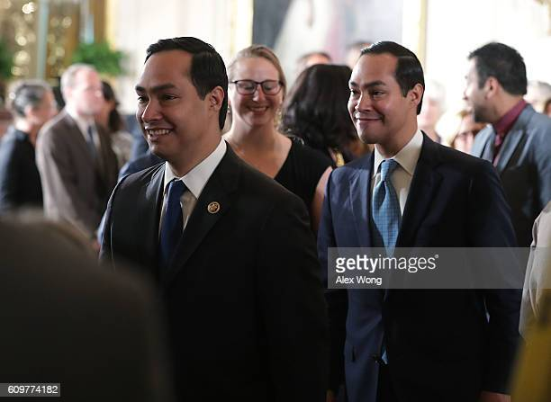 S Rep Joaquin Castro and his twin brother Secretary of Housing and Urban Development Julian Castro leave after an East Room ceremony at the White...