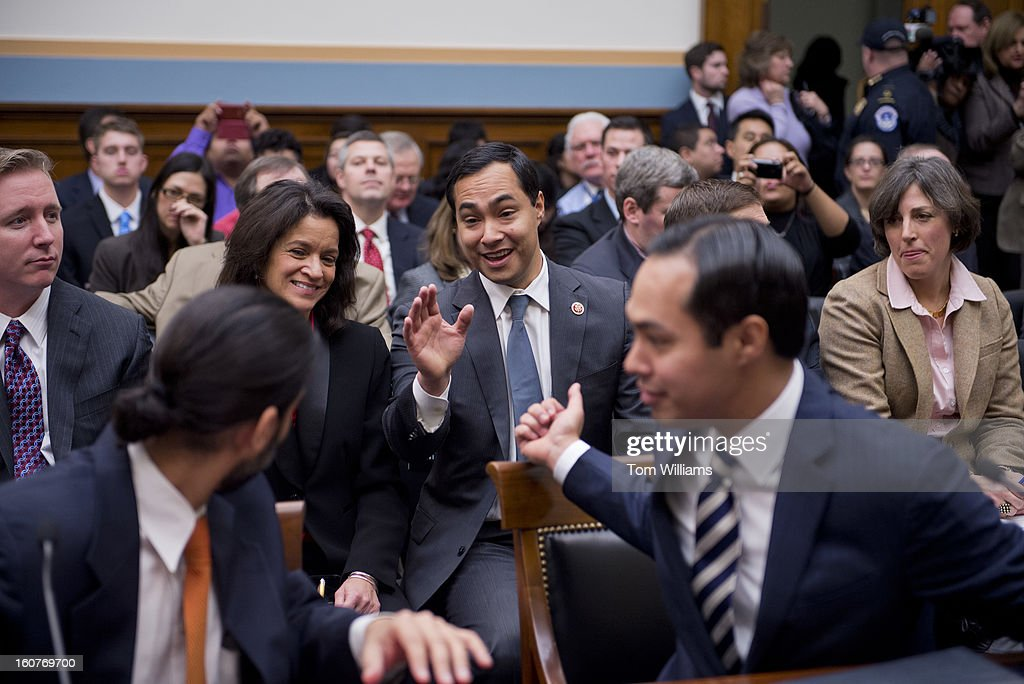 Rep Joaquin Castro DTexas center appears in the audience behind his brother Julian Castro mayor of San Antonio before a House Judiciary Committee...