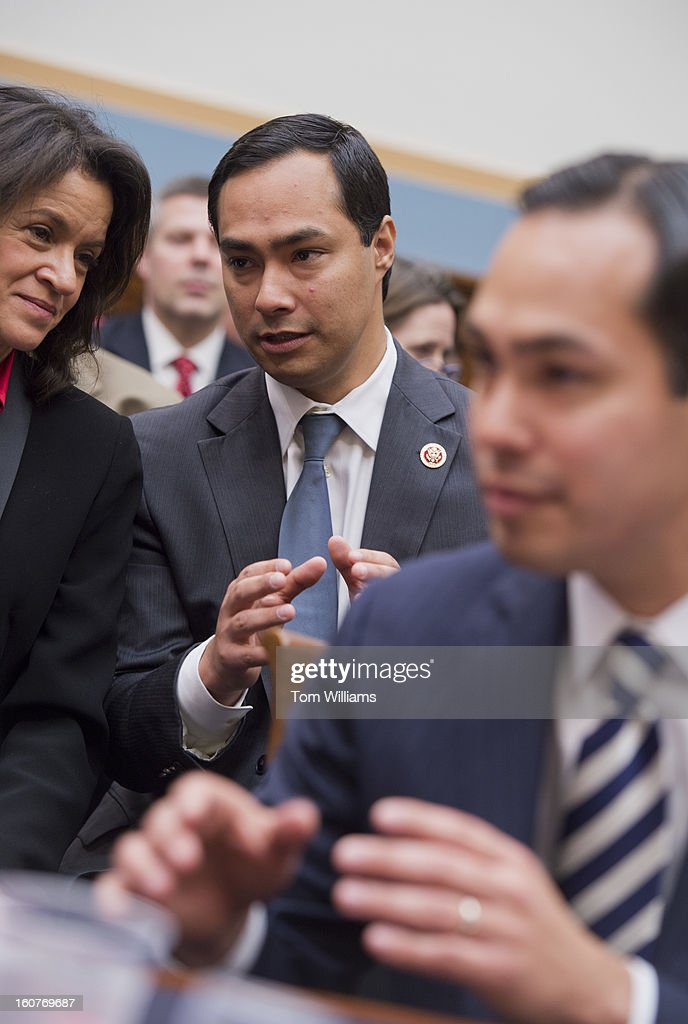 Rep Joaquin Castro DTexas left appears in the audience behind his brother Julian Castro mayor of San Antonio before a House Judiciary Committee...