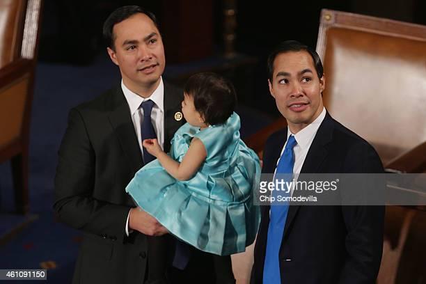 Rep Joaquin Castro holds his daughter Andrea Elena Castro as he and his twin brother Housing and Urban Development Secretary Julian Castro attend the...