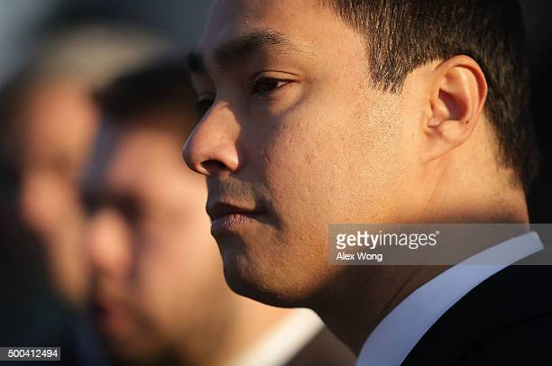 S Rep Joaquin Castro listens during a news conference in front of the Supreme Court December 8 2015 in Washington DC The Congressional Hispanic...