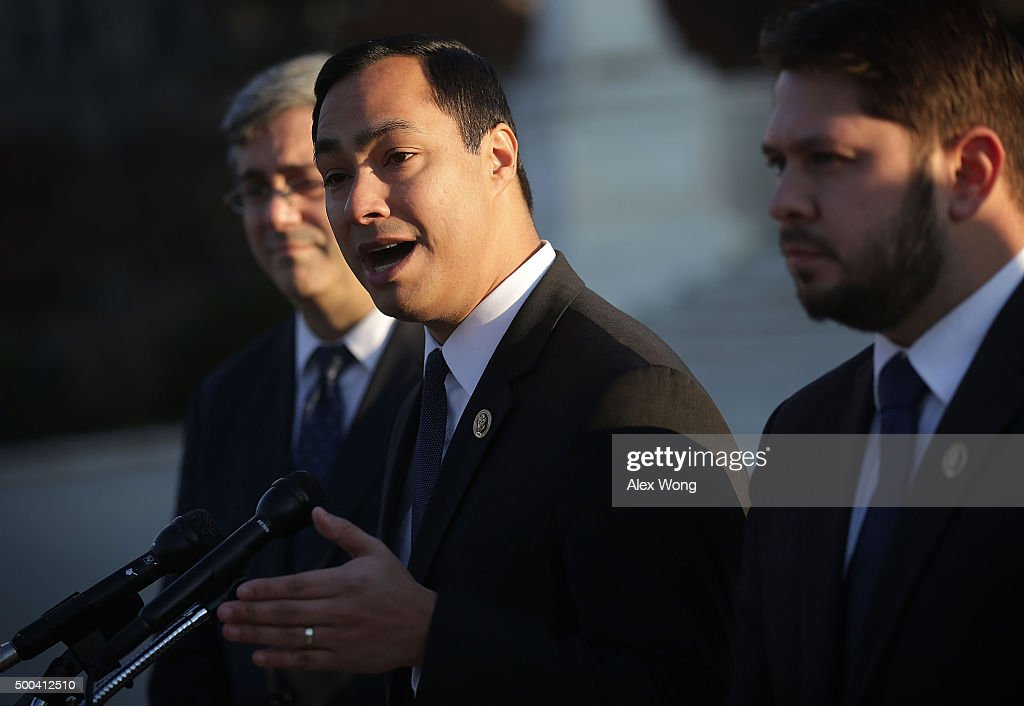 U.S. Rep. Joaquin Castro (D-TX) (2nd L) speaks as Rep. Ruben Gallego (D-AZ) (R) and Mexican American Legal Defense and Education Fund President and General Counsel Thomas Saenz (L) listen during a news conference in front of the Supreme Court December 8, 2015 in Washington, DC. The Congressional Hispanic Caucus held the news conference on the day the Supreme Court hears oral arguments on Evenwel v. Abbott, 'on whether voting districts should continue to be drawn by using census population data, which include noncitizen immigrants, or whether the system should be changed to count only citizens eligible to vote, as conservative challengers are seeking.'