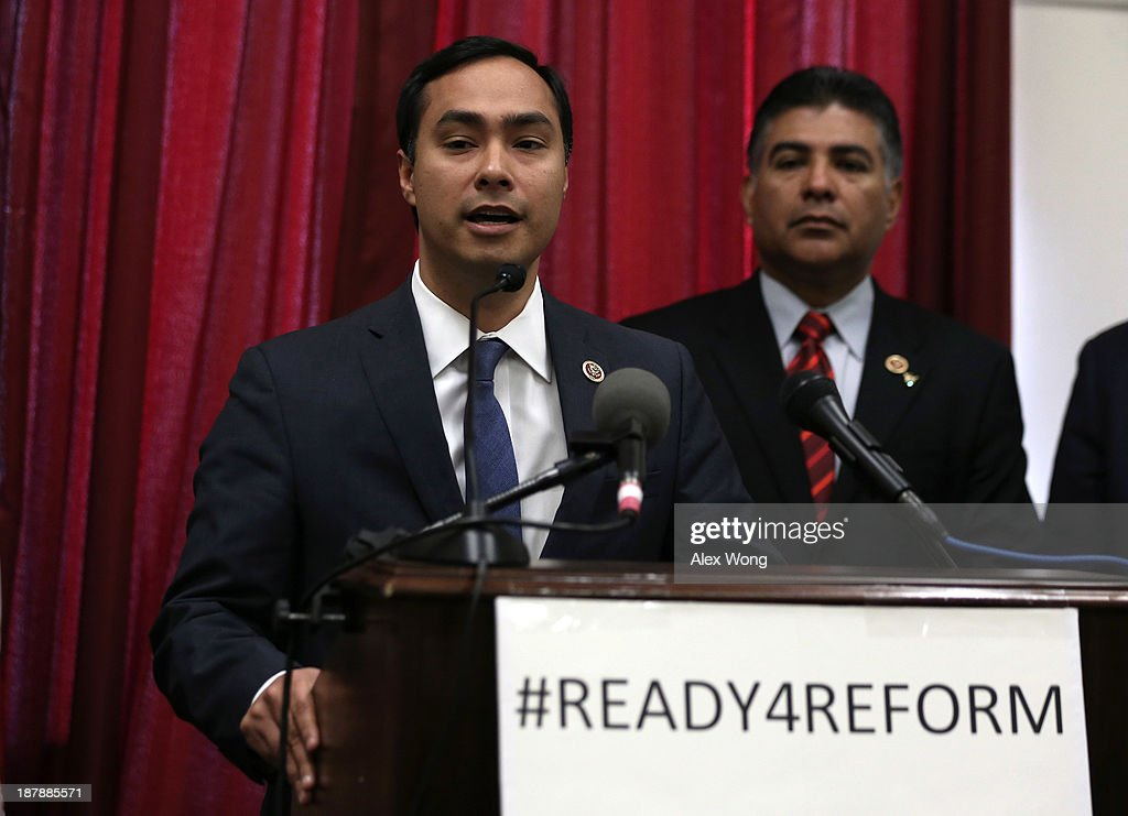U.S. Rep. Joaquin Castro (D-TX) (L) speaks as Rep. Tony Cardenas (D-CA) listens during a news conference on immigration reform November 13, 2013 on Capitol Hill in Washington, DC. The freshman House Democrats urged Speaker of the House Rep. John Boehner (R-OH) to pass the comprehensive immigration reform.