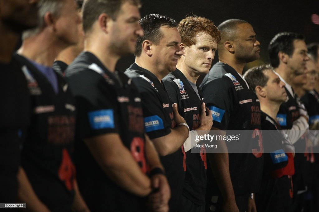 U.S. Rep. Joe Kennedy (D-MA) listens to the national anthem with other team members of the Mean Machine during pregame of 2017 Congressional Football Game October 11, 2017 at Gallaudet University in Washington, DC. Members of Congress and former NFL players team up against the U.S. Capitol Police for the biennial Congressional Football Game, which began in 2005 following the loss of Capitol Police officers John Gibson and Jacob Chestnut in the line of duty in 1998, to raise money to benefit the families of fallen police officers.