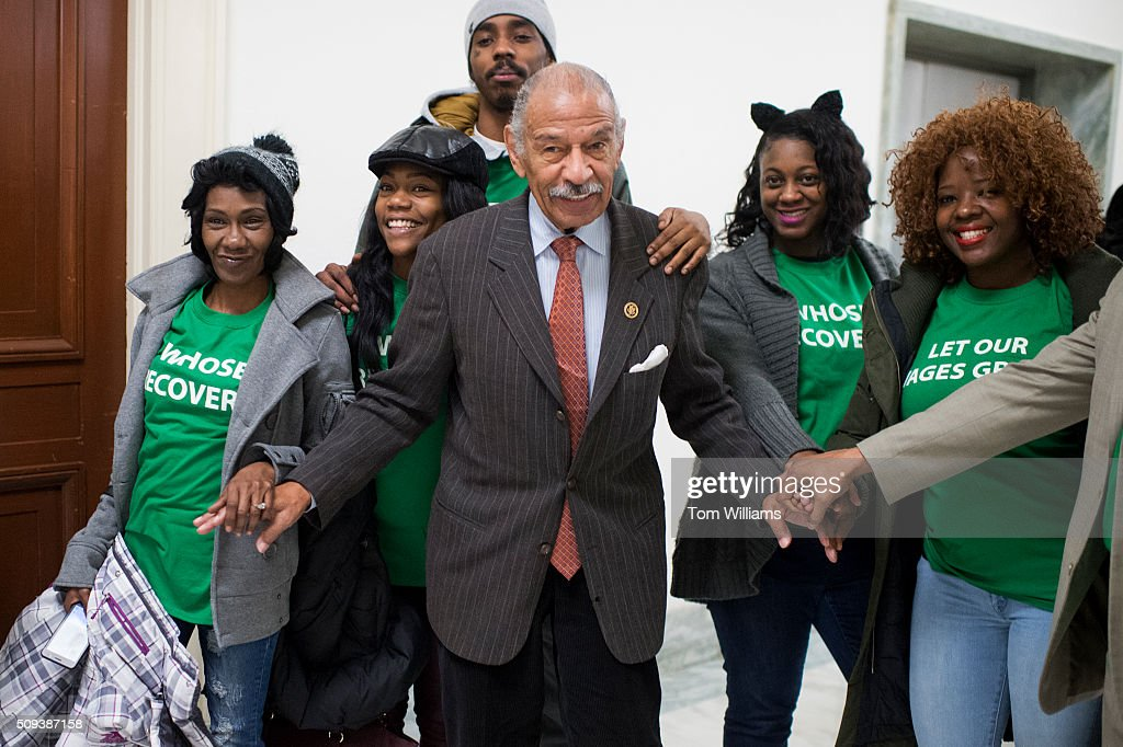 Rep. John Conyers, D-Mich., poses for a picture with members of the Center for Popular Democracy outside of a House Financial Services committee hearing in Rayburn titled Monetary Policy and the State of the Economy,' featuring testimony by Chair of the Federal Reserve Janet Yellen, February 10, 2016.