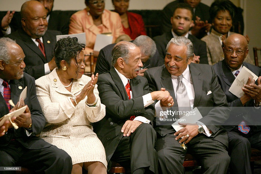 Rep. John Conyers, Jr. D-MI congratulates Rep. Charles Rangel, D-NY during the Ceremonial Swearing-In of The Congressional Black Caucus, 110 Congress, at The Jefferson Building of The Library of Congress. Conyers is Chairman of House Judiciary Committe and Rangel is Chair of The House Ways and Means Committee.